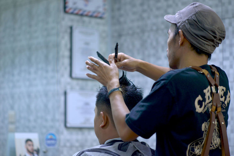 Barber Cutting Man Hair In Salon