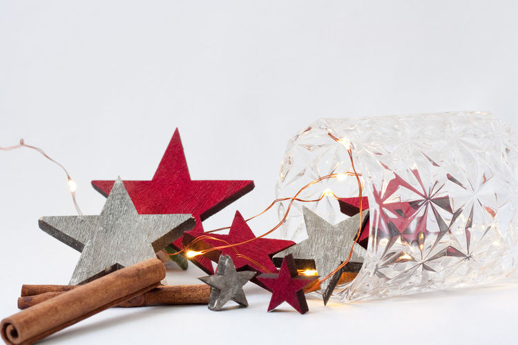 Merry Christmas! Copy Space Backgrounds Lighting Equipment Cinnamon Christmas Lights Studio Shot No People Close-up Still Life White Background Christmas Ornament Celebration Indoors  Holiday Illuminated Christmas Decoration Christmas Decoration Star Shape Shape Holidays