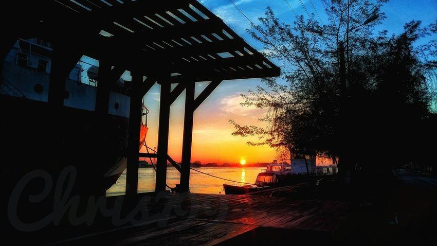 Danube Dawn Of A New Day Sunrise And Clouds Light And Shadow Dawn Sunlight Sun Behind Trees Tree Sunset Sea Water Silhouette Sky Horizon Over Water Shore Lifeguard Hut Sandy Beach Wave Cloud - Sky Calm Idyllic Scenics Beach Surf Pebble Beach Groyne Ocean Tranquil Scene