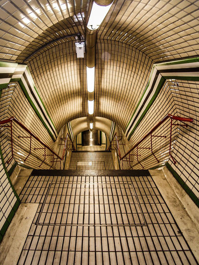 The Tube Architecture Indoors  Built Structure No People Transportation Staircase Underground Walkway Pattern Flooring Direction Subway Station Ceiling Public Transportation Lighting Equipment Illuminated Empty London Tube City Street Photography Subway