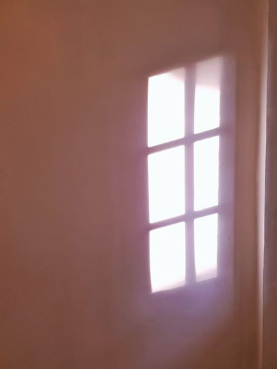 color on the white wall. White Wall Shadow Shade Sun Light Through Window Window Home Interior Close-up Sunshade Focus On Shadow Sunlight Corner Window Frame