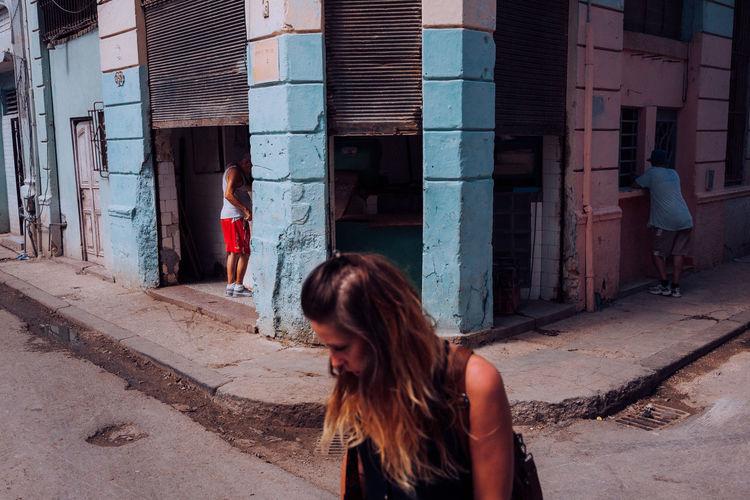 Full length of woman on street against buildings in city