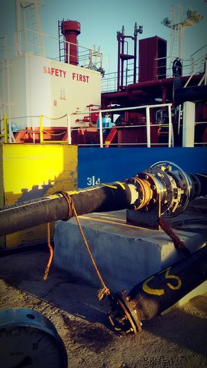 Safety First! Primary Colors Metal GasPipes Vessels In Port Port