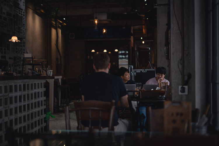 Moody Dark Images of Friends Talking in Cafe Real People Group Of People Indoors  Business Men Food And Drink Lifestyles People Young Adult Young Men Teamwork Occupation Working Restaurant Kuala Lumpur Malaysia Coffee Enjoying Life Entrepreneur Startup Hope Coffee Time Coffee Shop Moody Ijas Muhammed Photography