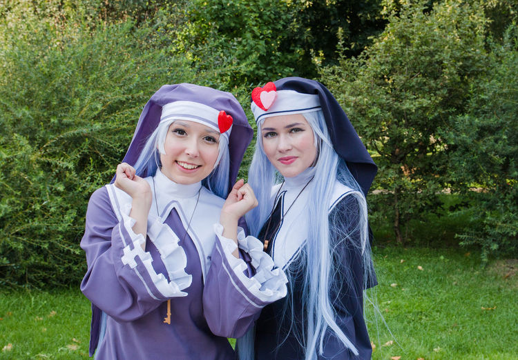 Cosplay Couple - Relationship Day Front View Grass Happiness Leisure Activity Lifestyles Looking At Camera Nature Outdoors People Plant Portrait Real People Smiling Togetherness Two People Waist Up Women Young Adult Young Women