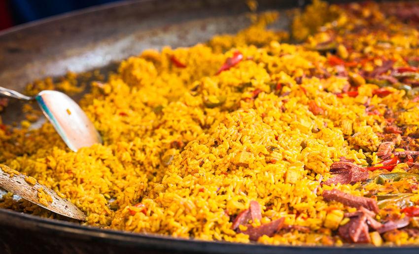 Paella on sale on a market stall in Joslin, France Paella Abundance Asian Food Choice Close-up Food Food And Drink For Sale Freshness High Angle View Indian Food Kitchen Utensil Market Market Stall No People Paella! Paellas Retail  Selective Focus Snack Still Life Street Market Variation Yellow