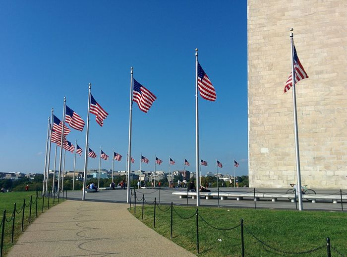 Flag flags on pole against blue sky