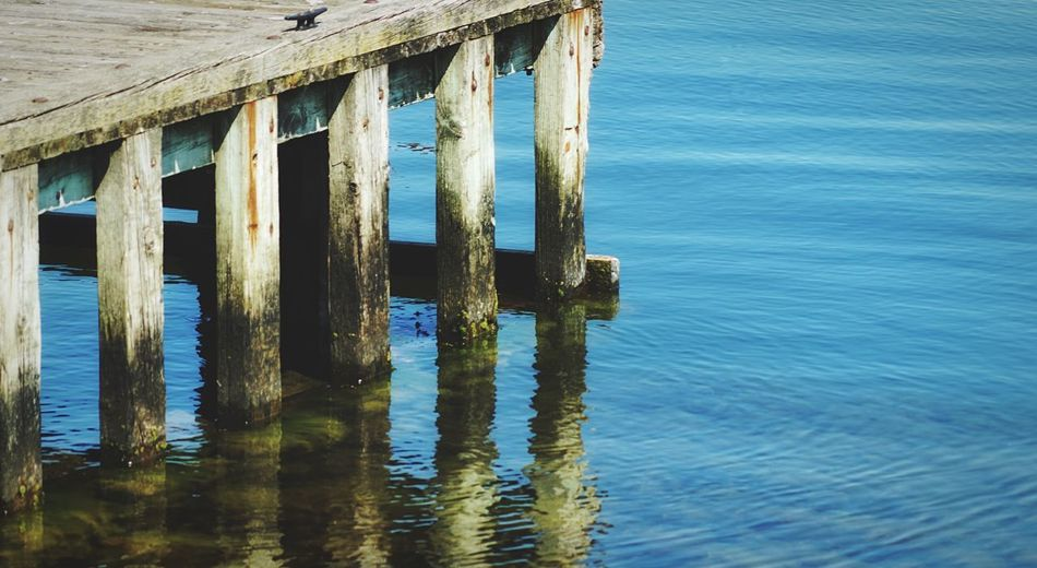 A reflection Water Wood - Material Sea Architecture No People Nature Waterfront Day Pier Reflection Tranquility Rippled Tranquil Scene Outdoors