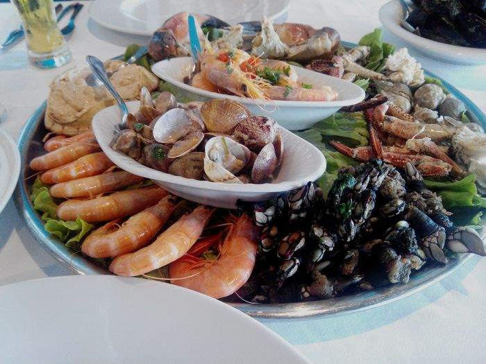 Seafood served on table at restaurant