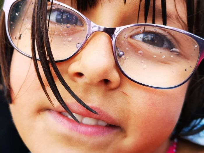 Smiling in the rain ... Looking At Camera Little Girl Smiling Unedited Color Photo Happy Childhood Smiling Eyes Different Perspective Smiling In The Rain Eyeglasses  Portrait Headshot Eyesight Close-up Eyelash Pretty Human Eye Iris - Eye Human Lips Eyeball The Mobile Photographer - 2019 EyeEm Awards The Portraitist - 2019 EyeEm Awards