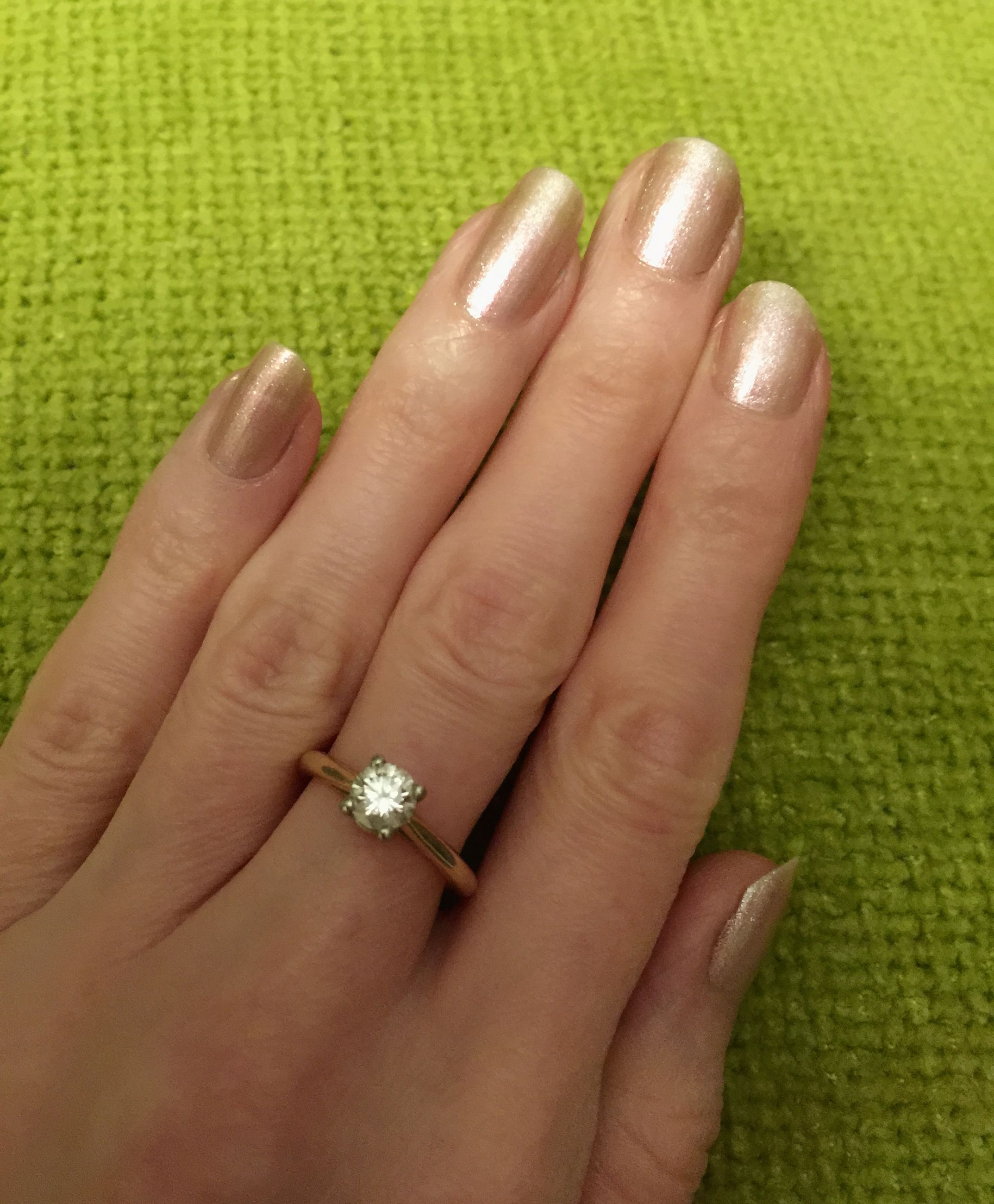 person, part of, human finger, holding, cropped, close-up, palm, ring, personal perspective, unrecognizable person, showing, indoors, focus on foreground, jewelry, lifestyles, nail polish