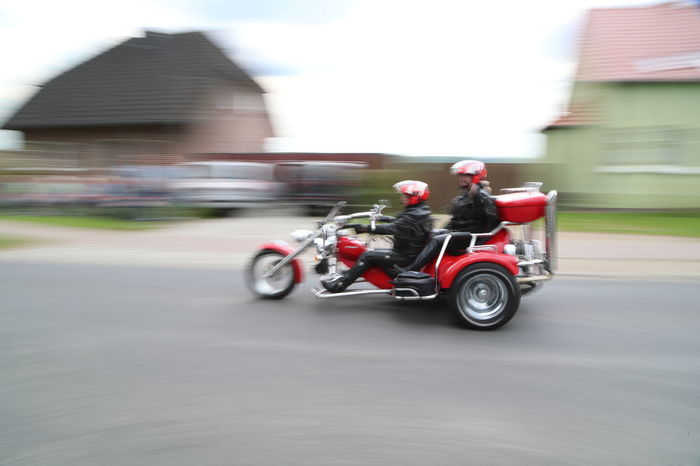 Architecture Blurred Motion Building Exterior Built Structure Day Helmet Land Vehicle Mode Of Transport Motion Motorcycle Outdoors Real People Riding Road Speed Transportation Trike Trikebike