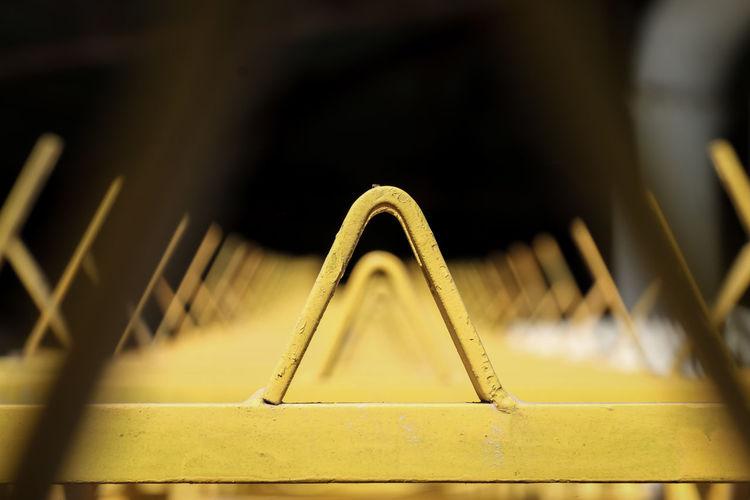 conveyor belt Transportation Conveyor Belt Yellow Industry Mining Triangle Large Focus Machinery Close-up Metal Rusty