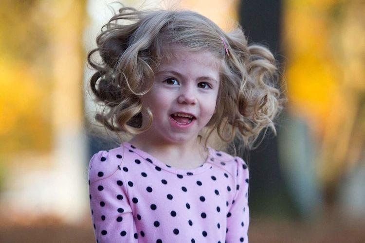 Portrait of cute blond girl
