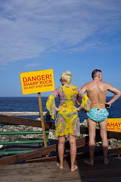 People And Places Couple TakeoverContrast Enjoying The View Thinking The Street Photographer - 2017 EyeEm Awards Street Photography Sea Middle Age Funny Couple Body Language Bali INDONESIA Tourist In My Town Tourist Sign Yellow Sign Danger Danger Sign Fresh On Eyeem  EyeEm Gallery Enjoy The New Normal People Together Colour Of Life Two Is Better Than One