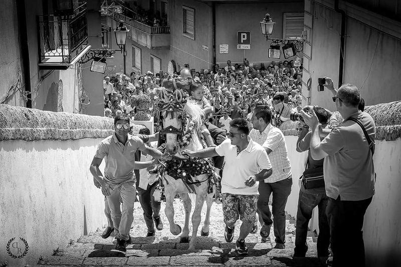 The promise ThePromise Racalmuto Sicilia Traditional Horse Love Blackandwhite Photography Street Street Photography Streetphoto_bw Street Art Streets Crowd Men Full Length Togetherness Fun Enjoyment Standing Celebration High Street Street Scene