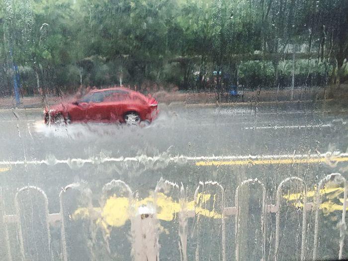 Guangzhou Car Raining Day Red Car Rain Drops