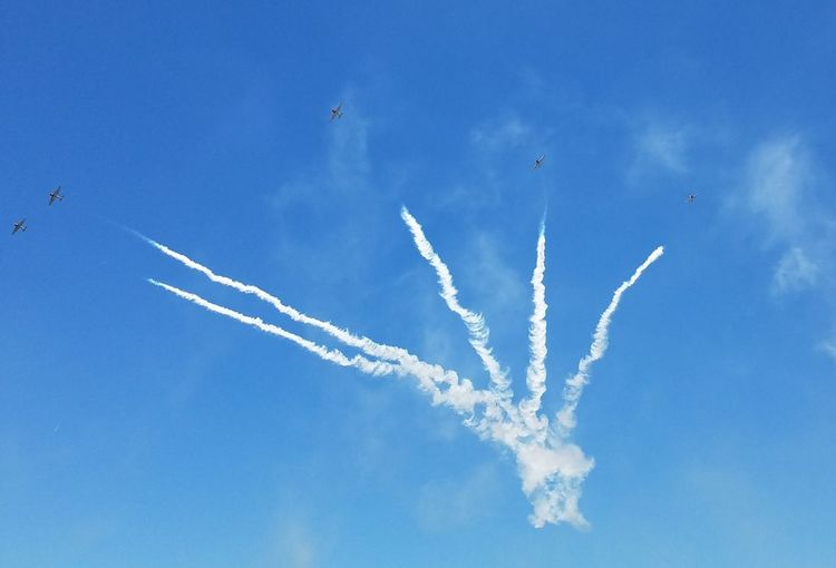 Vapor Trail Flying Airplane Airshow Blue Arrangement Air Vehicle Teamwork Sky Formation Flying Transportation No People Outdoors Fighter Plane Day Air Force Aerobatics