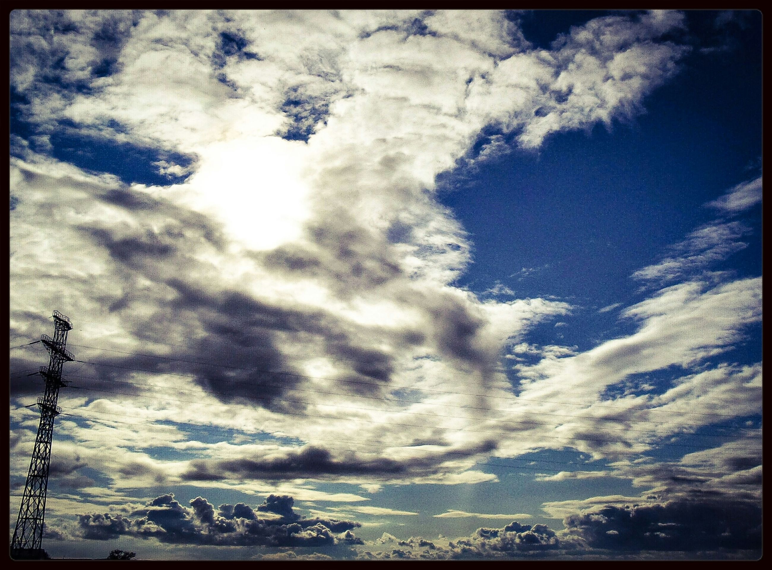 transfer print, sky, low angle view, cloud - sky, auto post production filter, cloudy, cloud, beauty in nature, nature, tranquility, scenics, weather, tranquil scene, blue, outdoors, cloudscape, no people, day, sunlight, overcast