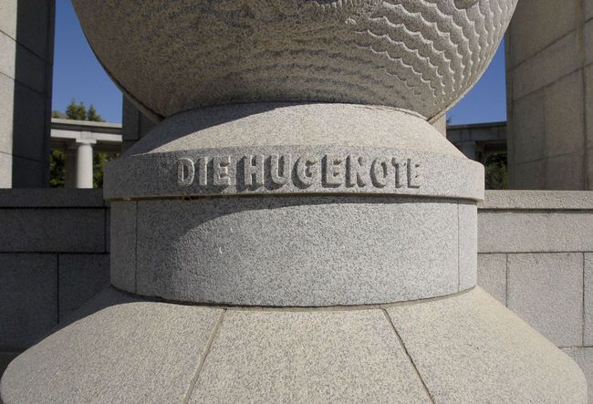 "CU ""Die Hugenote"" lettering on Huguenot Memorial, Franschhoek, South Africa Ancient Architectural Column Architectural Feature Architecture Built Structure Capital Cities  Column Day Famous Place Franschhoek Historic History Huguenot Memorial Museum Huguenot Monument No People Outdoors Sky South Africa Stone Material The Past Tourism Travel Destinations"