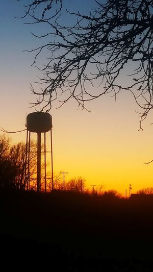 View of the Sun Setting by the Watertower from my Front Yard in Oklahoma. No People Bare Tree Country Road Sunset Silhouettes Oklahoma Sunsets Beatiful Sky OklahomaSkies Oklahoma Nature Beautiful Day Beautiful Nature Oklahomaphotography Sunset Silhouette Nature Water Tower - Storage Tank Storage Tank Tree No People Beauty In Nature Outdoors Sky Day EyeEmNewHere
