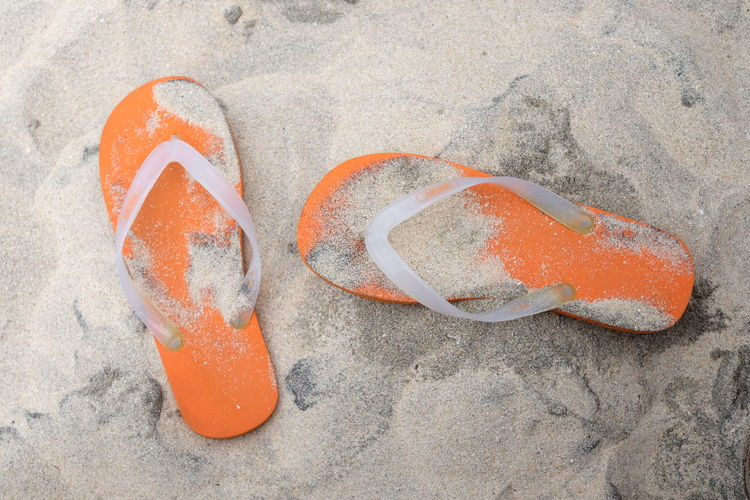 Sandals Sand Orange Color Land No People Beach Day Outdoors Nature