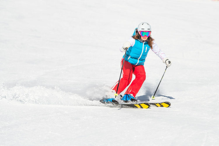 Full length of woman skiing on snow