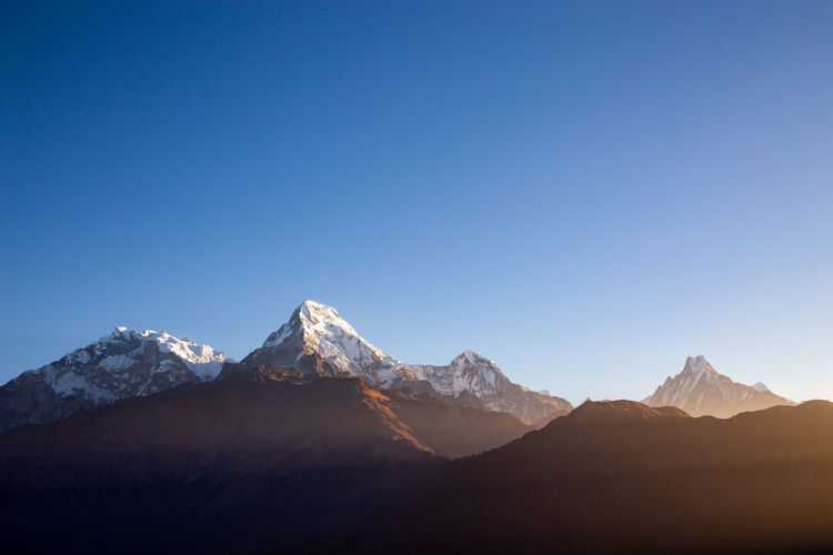 Sunrise over Annapurna very early in a morning of November. Last destination from a 9 days trek till Annapurna Base Camp. Sight from popular Poon Hill. Mountain Mountain Range Sky Scenics - Nature Beauty In Nature Environment Landscape Mountain Peak Snow Clear Sky Winter Nature Tranquil Scene Blue Copy Space Tranquility Cold Temperature Outdoors Bright Annapurna Nepal Travel Sunrise Morning Himalaya First Eyeem Photo My Best Photo The Great Outdoors - 2019 EyeEm Awards