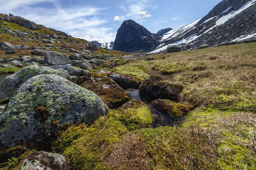Hiking Norway Beauty In Nature Day Environment Flowing Water Hiking Adventures Land Landscape Mountain Mountain Peak Mountain Range Nature No People Outdoors River Rock Rock - Object Scenery Scenics - Nature Sight Sky Snow Solid Stream - Flowing Water Tranquil Scene Tranquility Water Wilderness