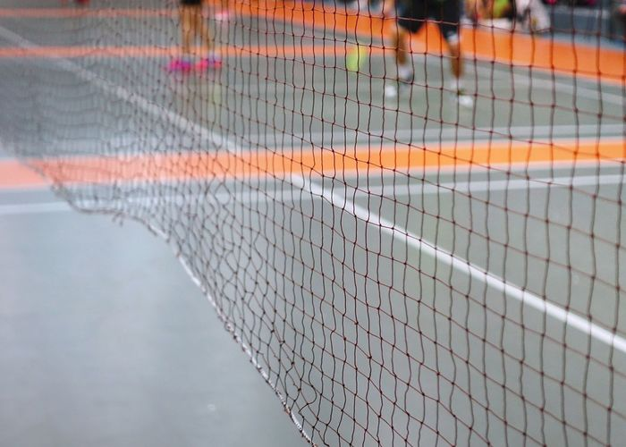 Close-up of net against the sky