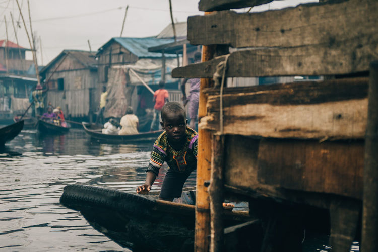Peaking TheWeekOnEyeEM Thewaysofseeing Boy Nautical Vessel Transportation Wood - Material Men Water Mode Of Transportation People Males  Architecture Outdoors Fisherman Full Length Clothing Motion Nature Canal Occupation