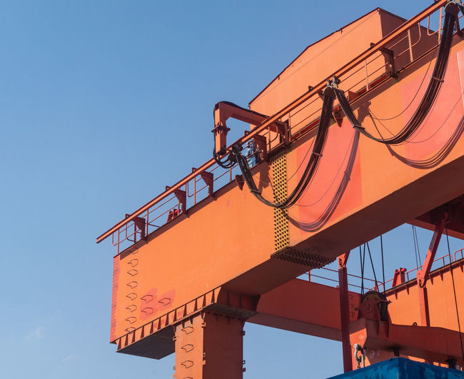 Low angle view of crane against clear sky during sunset