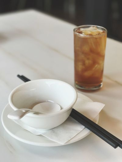 Cup With Drink Glass On Table