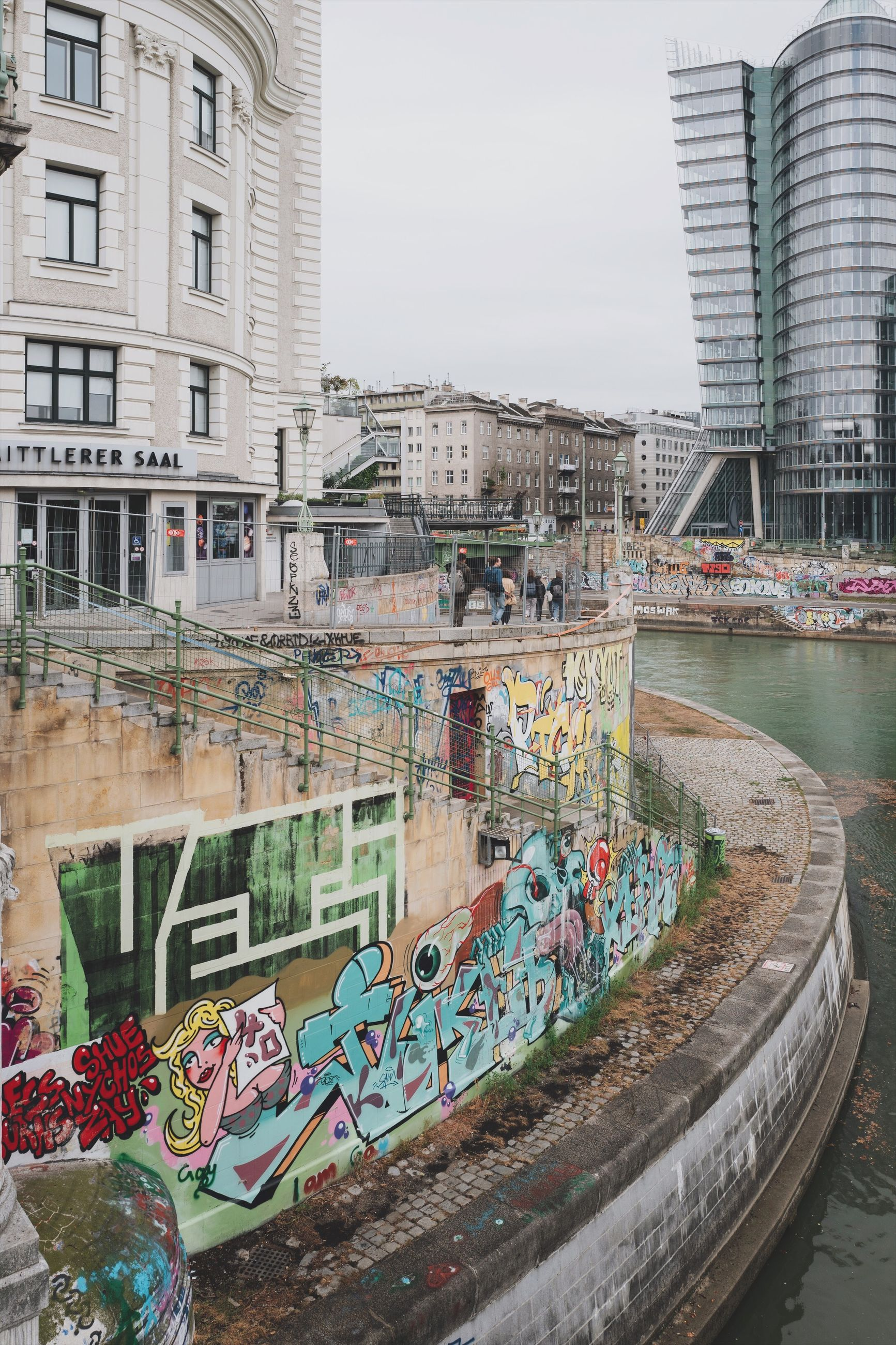 built structure, building exterior, architecture, water, city, graffiti, day, building, nature, creativity, art and craft, multi colored, canal, no people, reflection, outdoors, transportation, sky, city life, office building exterior