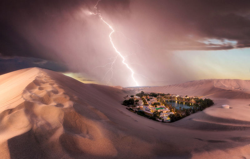 Lightning in sky over mountains
