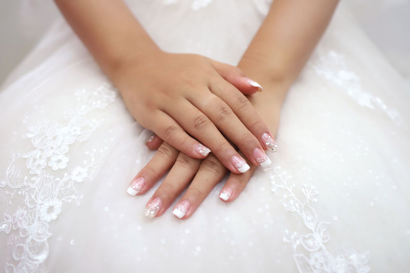 Human Hand Women Hand Human Body Part Adult Indoors  Real People Nail Polish Nail Two People Midsection Lifestyles Leisure Activity Close-up People Body Part Focus On Foreground Finger High Angle View Day Beautiful Woman Luxury Medicure Bride Fashion