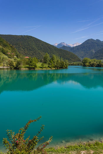 Slovenia Beauty In Nature Blue Day Emerald Europe Lake Mountain Mountain Range Nature No People Outdoors Peaceful Reflection Relax River Scenics Sky Tranquil Scene Tranquility Tree Water