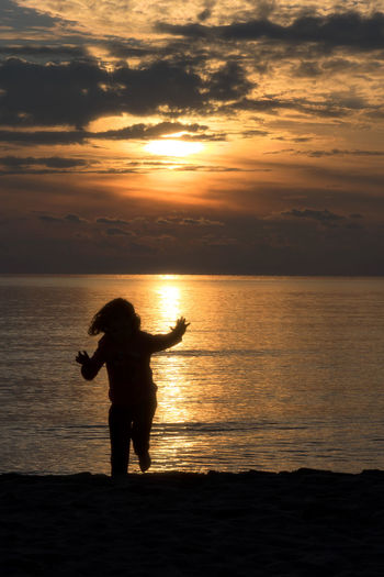 Tuscany Sunset_collection Sunset Beach Silhouette Sea Reflection Sun Water One Person Vacations Full Length Horizon Over Water Beauty In Nature Nature Children Only Tranquil Scene Scenics Tranquility Sky Sunlight Standing