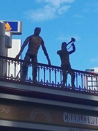 these sculptures are made of dried leaves 🍁 Bugle  Trumpeter 🎺 Blow Your Trumpet PublicArtwork Public Art On The Roof Blue Sky Balcony Streetart Street Art Trumpeter PublicArtworks Public Artwork ArtWork Street Photography Taking Photos Streetphotography Two People Check This Out Statues/sculptures Sculptures/statues Full Length Silhouette Sculpture Railing Sky Statue Human Representation Sculpted
