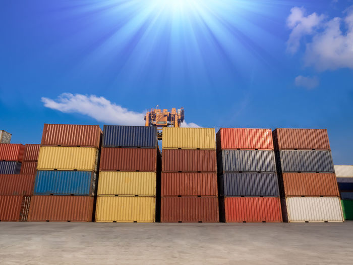 Stacking of containers in yard. logistics background Blue Cargo Container Closing Time Cloud - Sky Crane Day Delivery Discharging Expo Freight Transportation Import Industry Lift Loading Logistics No People Outdoors Port Rtg Shipping  Sky Stacking Storage Sunlight Yard