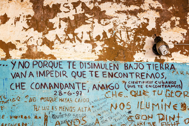 VALLEGRANDE, BOLIVIA - AUGUST 6: Graffiti in the laundromat where the body of Che Guevara was displayed in Vallegrande, Bolivia seen on August 8, 2014. The graffiti is by the Cuban team that discovered his body Argentine Argentinean Bolivia Che Che Guevara Communism Communist Cuban Ernesto Che Guevara Guerilla La Higuera Memorial Revolutionary South America Tourism Travel Travel Destinations Vallegrande