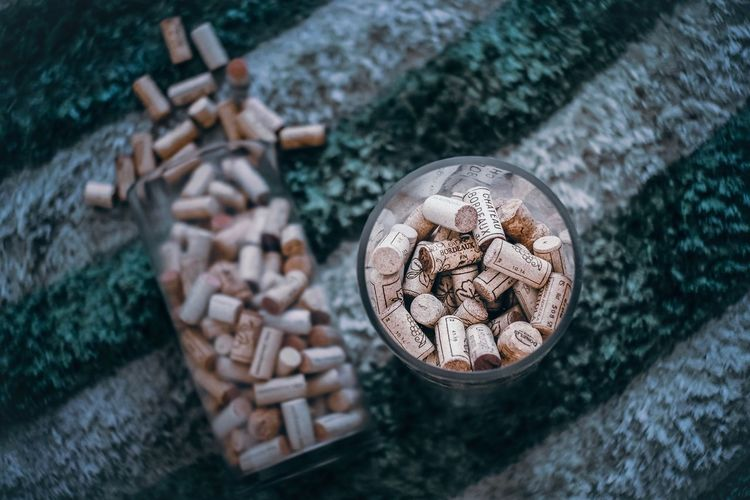 High angle view of wine corks in drinking glasses on table