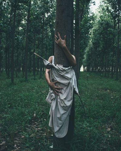 Tree Green Color Outdoors Leisure Activity One Person Day Grass Full Length Lifestyles People Standing Tree Trunk Men Human Body Part Only Women Melancholy Portrait