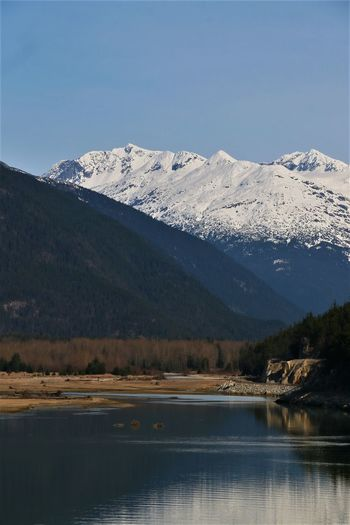 Mountain Water Scenics - Nature Winter Sky Beauty In Nature Cold Temperature Snow Tranquil Scene Lake Tranquility Mountain Range Nature Snowcapped Mountain No People Day Landscape Non-urban Scene Outdoors Mountain Peak Ocean Inlet Calm Water Road River Dyea Alaska