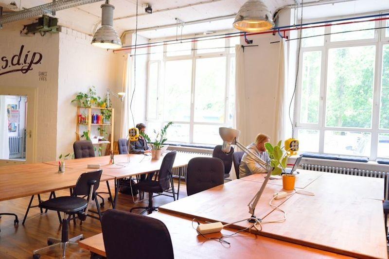 A coworking office in Berlin (ESDIP Berlin) Coworking Space Dining Table Freelancer Mac Office Windows Work Working