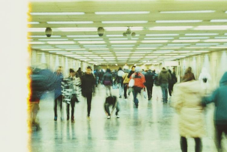 People in shopping mall against sky