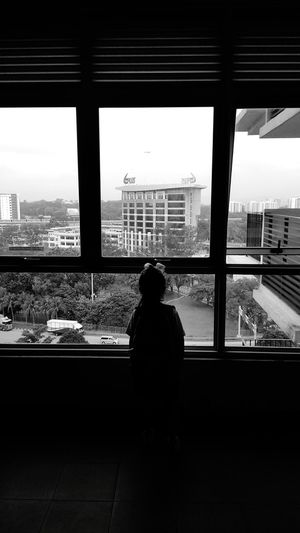 Cage | Day 75 of Black and White Photography Kid Daughter School Uniforms Around The World Morning Airplane Malaysia SabbirAhmedSaby Blackandwhite Unaaghor Downgrade Xiaomiphotography Redmi5a Tree Artiseverywhere Throughmyeyes Mobilephotography Road Green Blue City Cityscape Urban Skyline Skyscraper Looking Through Window Silhouette Window Sky Architecture Built Structure Transparent