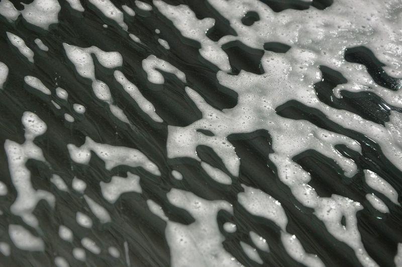 Full frame shot of raindrops on rainy day