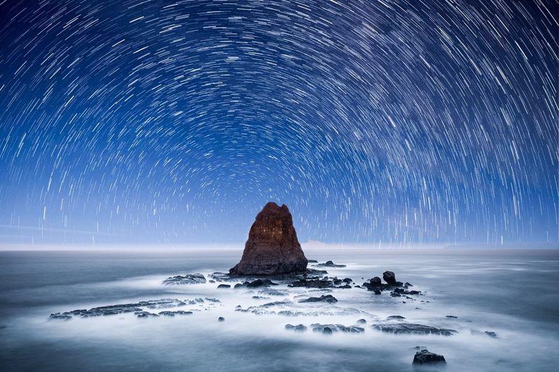 Papuma Beach Star Trails Star Trail Papuma Beach Sky Beauty In Nature Scenics - Nature Night Environment Tranquility Nature Blue Space No People Tranquil Scene Landscape Rock - Object Water Star - Space Astronomy Solid Long Exposure Land Rock Capture Tomorrow