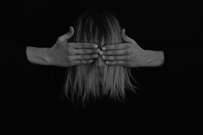 Eye does not see ... heart does not hurt... Feelings Self Portrait Getting Inspired One Person Studio Shot Black Background Indoors  Hand Human Hand Hair Portrait Front View Obscured Face Long Hair Human Body Part Women Real People Unrecognizable Person